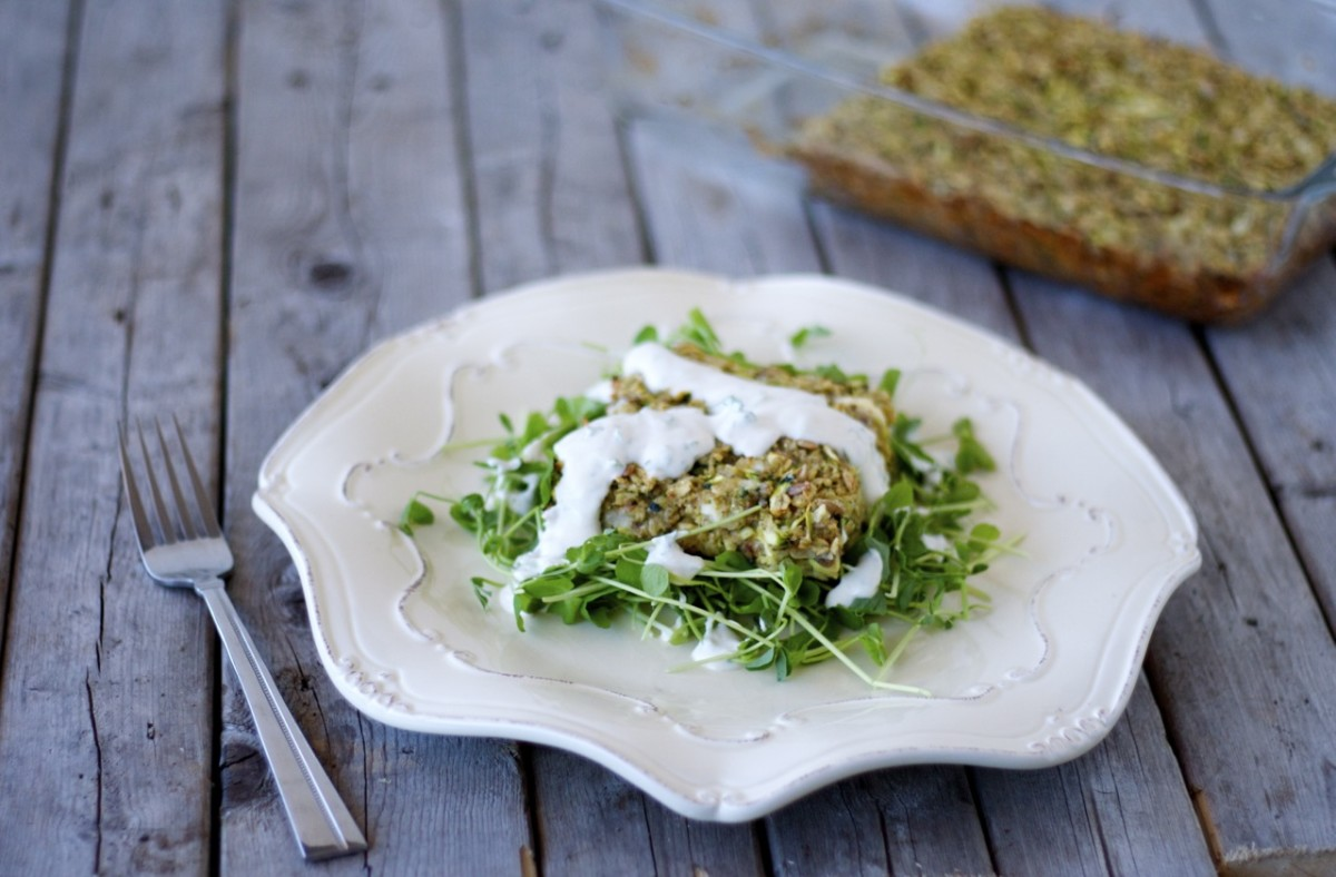 Zucchini-feta squares with tahini-yogurt sauce